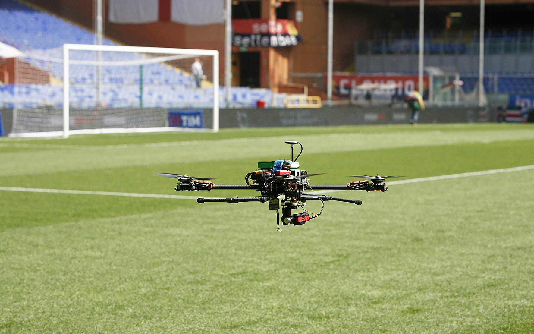 drone hovering on soccer field